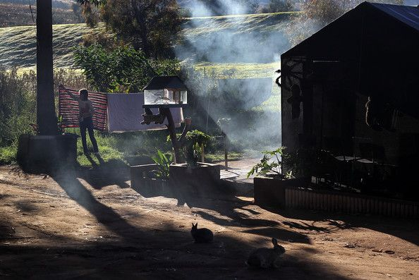 A woman checks her laundry outside her shack at a White South African squatter camp on June 7, 2010 in Krugersdorp, South Africa. The local municipality tried to evict the squatters from the land last year to make room for a fan park for the soccer World Cup, but a judge ruled that they could remain. The government then cut off the electricity to the camp. Many poor whites living there blame affirmative action programs launched by the ANC government for their unemployment and poverty.