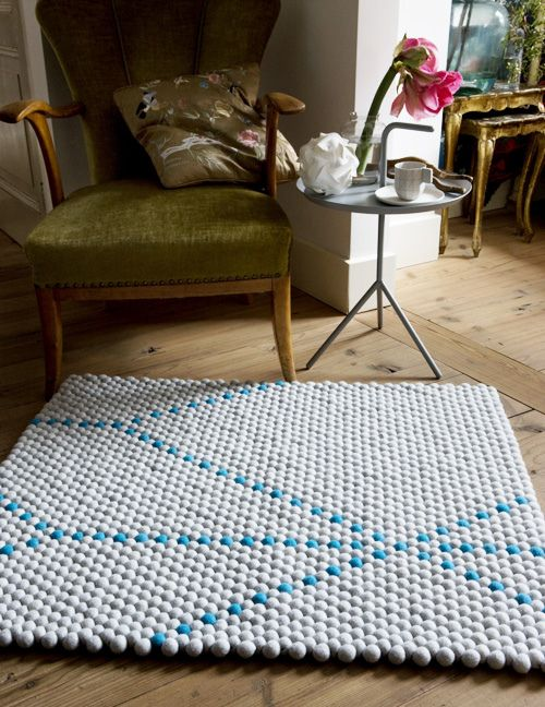Dot Carpet - 100% wool rugs made of felt balls. Neutrals with a pop of color! There's even a hot pink one.