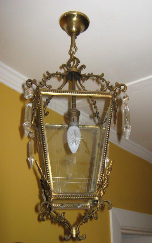 Pair of antique brass lanterns with sandblasted glass panels