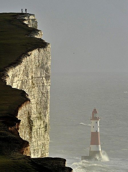 Beachy Head lighthouse and the white cliffs of Dover, East Sussex, UK