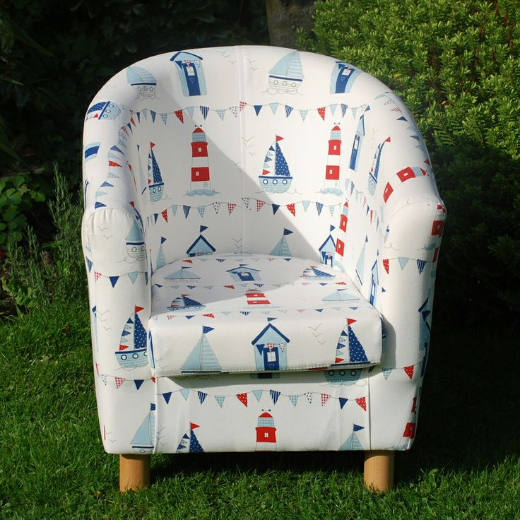 Kid's Maritime Tub Chair in blue, red & white colours and sea-side designs. The chair is made using soft, durable fabrics with lighthouse, boat, beach hut & bunting designs. Available in store at Curiosity Interiors, Alfreton or online at www.curiosityinteriors.co.uk