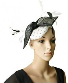 """Coccinelle"""" White and BlackFascinator. A beautiful full well-rounded design available in a lovely selection of colours, Sitting atop a matching satin headband, the half rounded sinamay cap features gorgeous polkadots, a large sinamay bow and finished with a spray of feathers. $69.95 including gift box and FREE shipping in Australia."""
