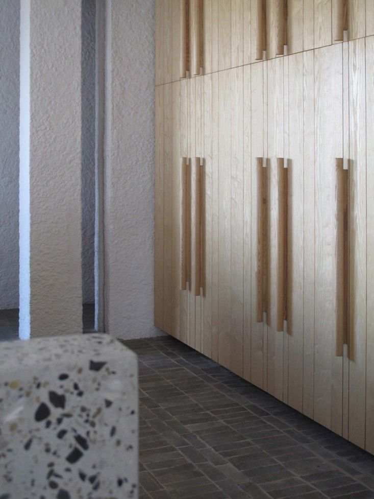 Ash wood veneer kitchen cabinets and solid wood turned handles in Swartberg House by Openstudio Architect in Great Karoo, South Africa | Remodelista