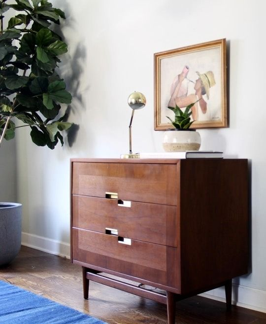 A vintage 3-drawer dresser made by American of Martinsville. Made of walnut and with the signature 'X' inlay design on top, everything including the brass hardware is in mint condition.
