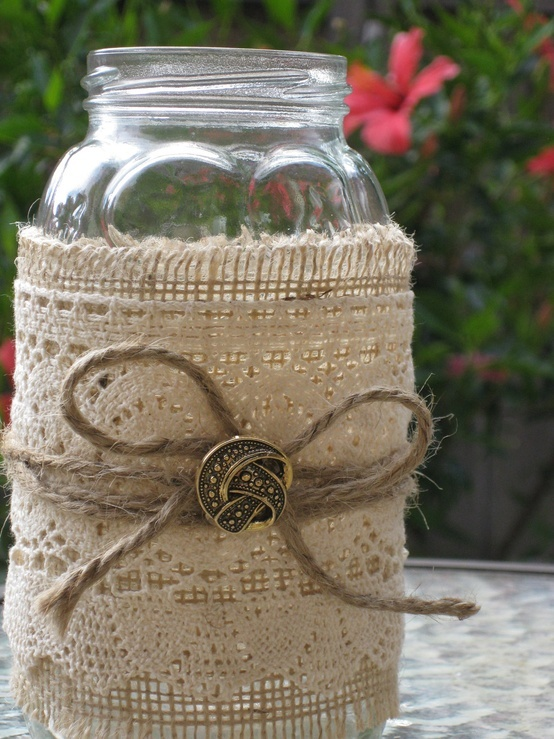 Burlap, lace, twine, and a vintage button on a glass jar make for nice vintage wedding reception table top decor, flower vase; upcycle, recycle, salvage, diy, repurpose! For ideas and goods shop at Estate ReSale & ReDesign, Bonita Springs, FL