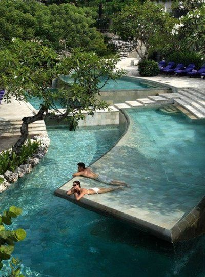 Now this is a solid idea. A slightly concave pool flooring that makes it easy to sunbathe and be in shallow water at the same time. Construct a pool in this way? Or one side of the pool?  Maybe a wading pool out on the terrace to sunbath in privacy