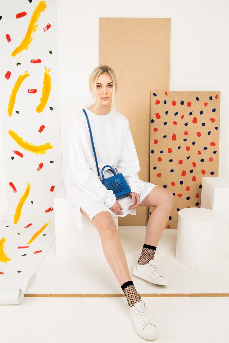 Mini Tote - Blue  £495.00  H15.5cm x W20.5cm x D7.5cm  - Cobalt-blue, Italian vegetable-tanned calf leather.  - Laser-cut disclaimer front and unique barcode on the side.
