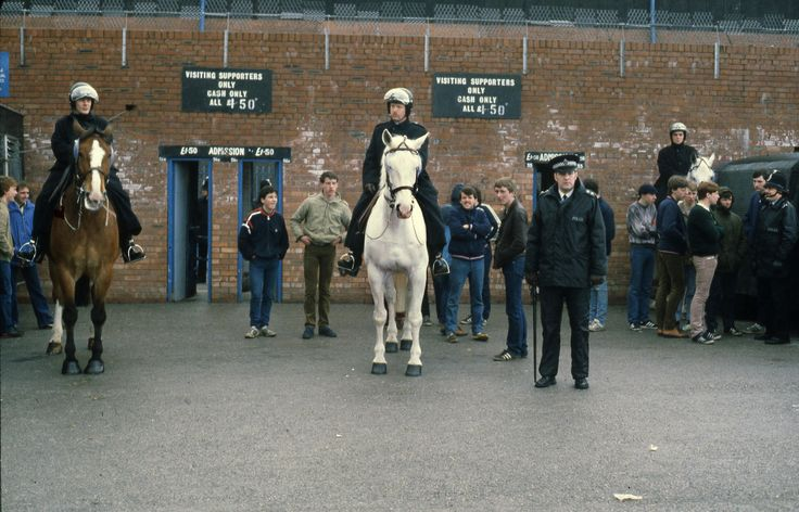 Greater Manchester Police officers and fans outside the visiting supporters entrance to Manchester City's Maine Road stadium. We think this image dates from the early 1980s. The famous ground was a Manchester sporting landmark for many years before closing in 2003. www.gmpmuseum.co.uk