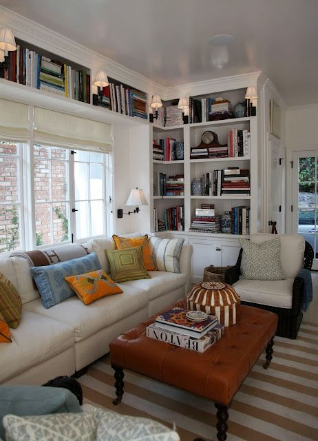 smart use of space for a home library... extending the shelving above and around a window