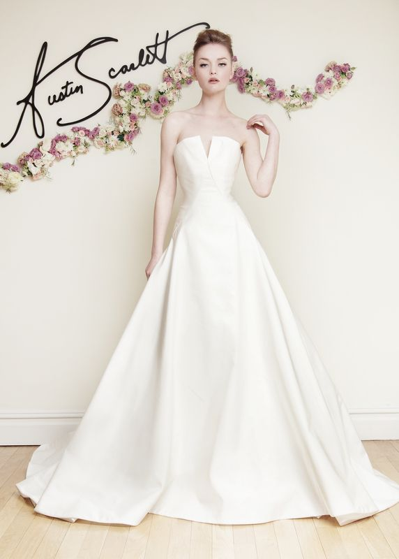 """AS72 """"Carrara"""" Silk Radzmir flat front ballgown with origami bow décolletage. Bodice dips to low drop waist in back with full gathered train. Also available in Silk Taffeta."""