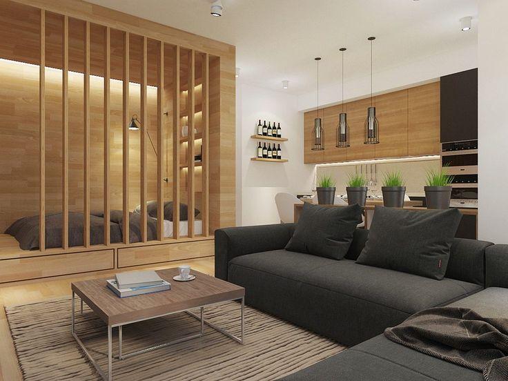 Fa felületek lágyítják a sötét és világos elemek kontrasztját az érdekesen berendezett 50m2-es lakásban