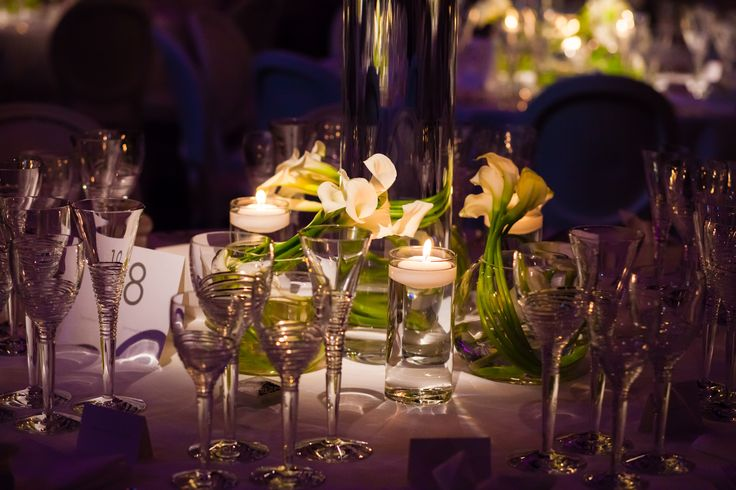 http://www.collection26.com/weddings/portfolio/ Calla lilies surround the main arrangement, wrapped inside a small glass globe #tablesetting #weddingflowers #contemporarywedding