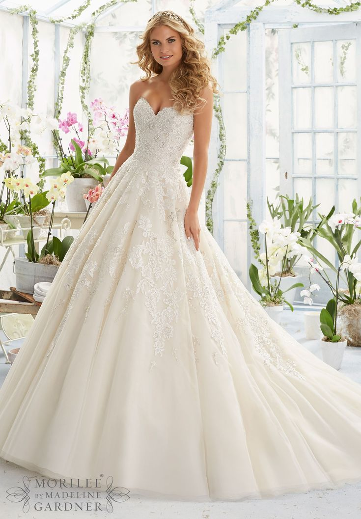 Wedding Dresses and Wedding Gowns by Morilee featuring Pearl and Crystal Beading on elegant Embroidery that decorates the classic Tulle ball gown Colors available:White, Ivory, Champagne.