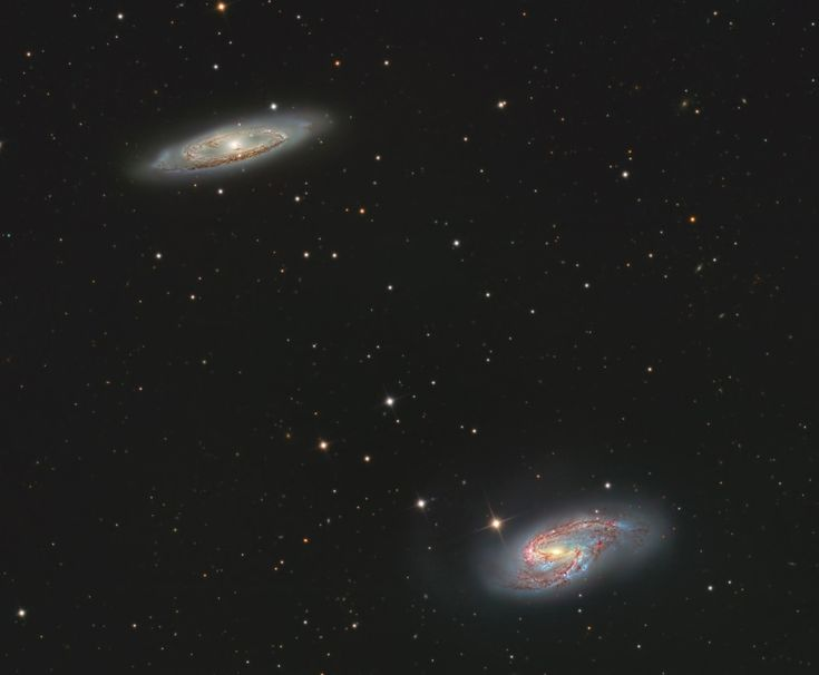Nearby and bright, spiral galaxies M65 (top) and M66 stand out in this engaging cosmic snapshot.