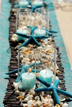 Shells in burlap table decorations | Table Decor - shells and collected driftwood, blue candles and table ...