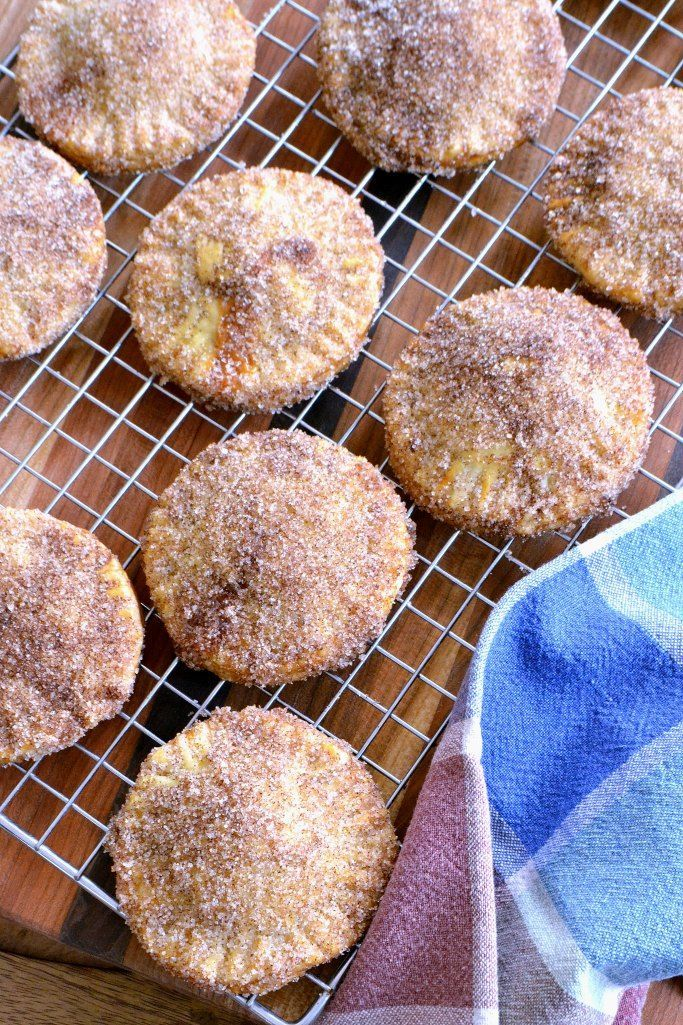 Serve up a fresh churro-inspired treat with a surprise filling inside at your gathering. This Mini Cajeta-Stuffed Churro Pies recipe is to die for!
