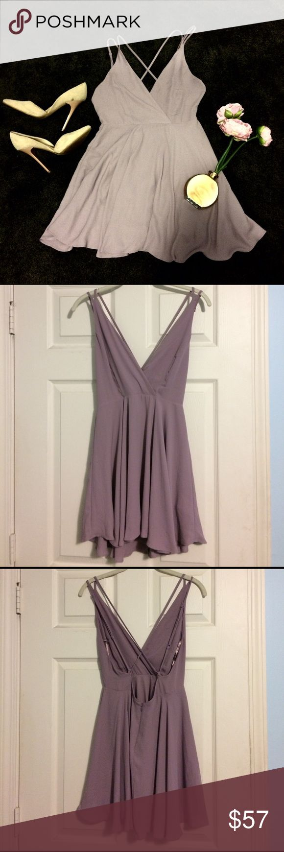 Purple chiffon kimichi blue dress urban outfitters NWOT. I LOVE LOVE LOVE this dress and am sad to let it go, but it doesn't fit me right anymore. It is a dusty purple chiffon dress, from Urban Outfitters kimichi blue. Strappy crossback and zip up skirt. Such a pretty dress. Looking to find this in medium. Still selling it in small. Never wore it anywhere but tags were removed. ❌no trades 💌ships same or next day except weekends Urban Outfitters Dresses