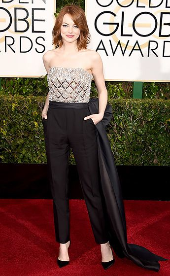Emma Stone Stone, who was accompanied by her brother Spencer, chose a bow-cinched Lanvin jumpsuit with a bedazzled bodice