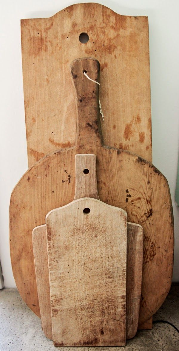 Vintage Wooden Cutting Boards. Usable and a great way to decorate the kitchen.