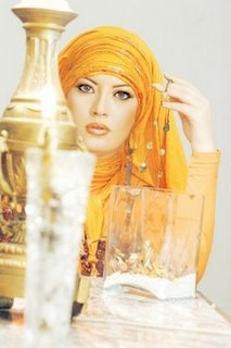 everything is golden for this lovely lady in her Egyptian hijab