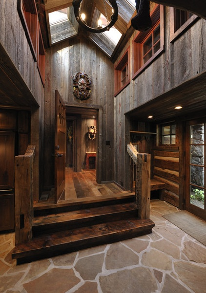 Barndominium Interior Designs | eclectic entry by Lake Country Builders