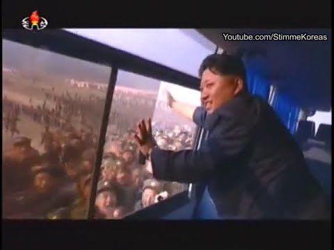 North Koreans running besides Kim Jong Un's bus - YouTube