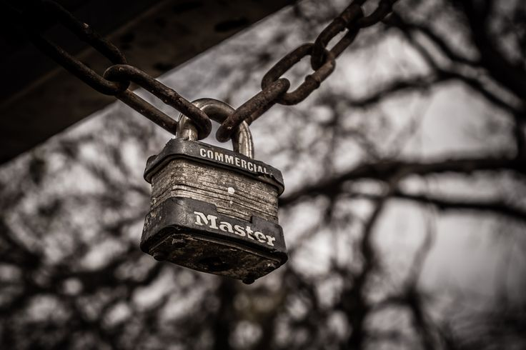 A padlock hangs from a chain in Richardson Texas Breckinridge Park.  See more #photos at 75central.com