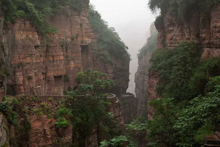 Guoliang Tunnel Road | One can feel the energy that these villagers needed to built this road. There are a few examples of these carved mountain roads in the area and we were speechless by this fascinating achievement.