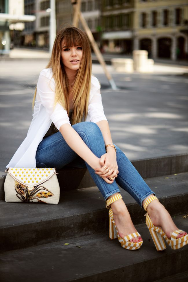statement heels and bag with casual chic outfit