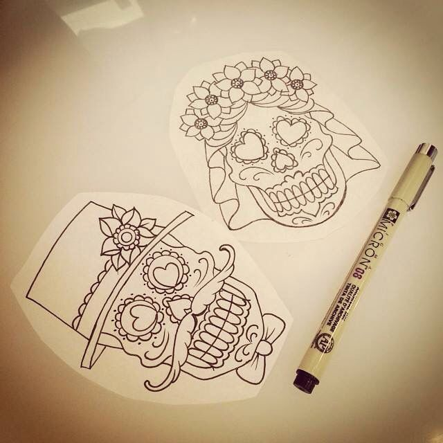 Bride and groom sugar skulls