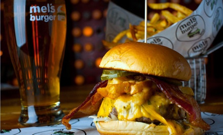 Mel's Burger Bar – Upper West Side  Two Burgers and a Half-Gallon Growler of Beer. Four-Person Option Available (Up to 56% Off).      Chefs construct slew of classic and innovative burgers from Pat LaFrieda meat, washed down with choice of 18 domestic craft brews.