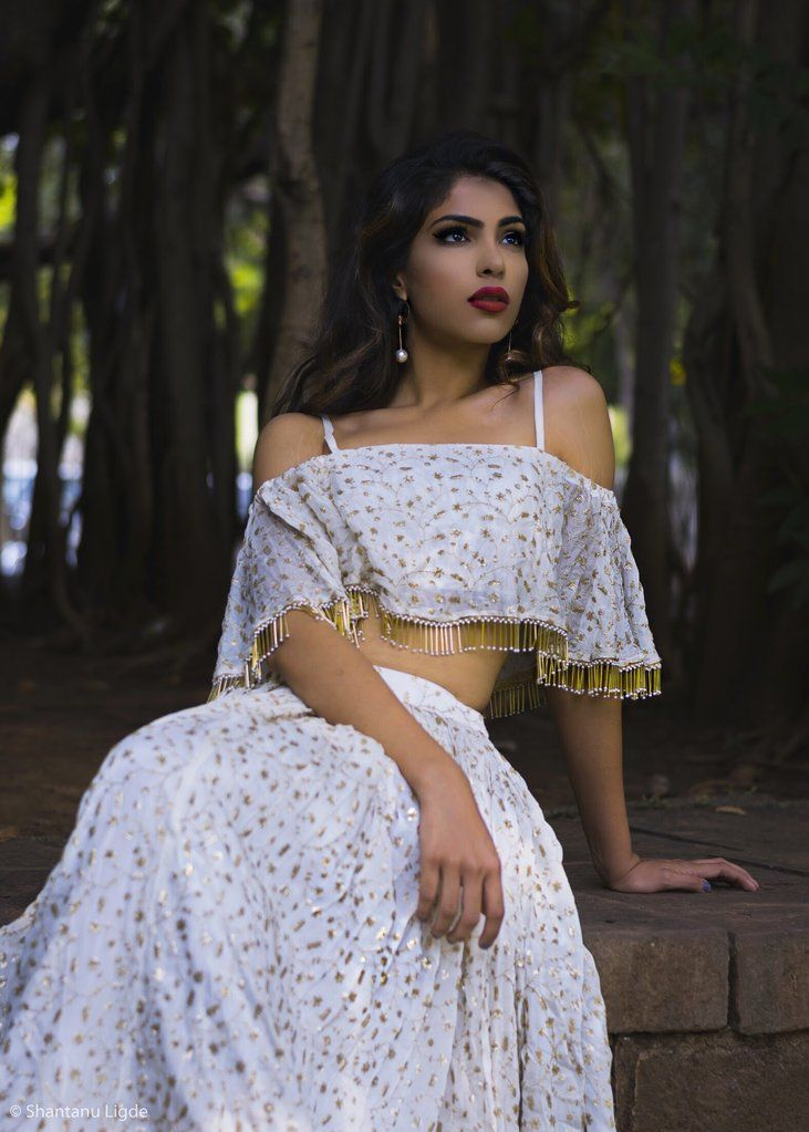 Off shoulder white and gold ghagra choli with golden pearled glass tassles