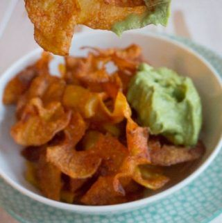 Recipe for vegan, super crispy Potato Twisters served with an Avocado Coriander Dip. A healthy alternative to the traditional fried Twisters.