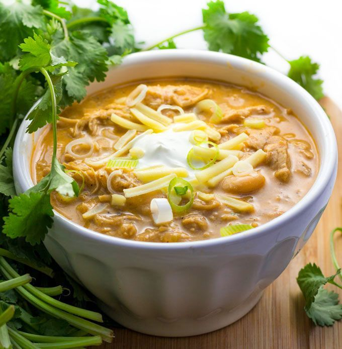 This white chicken chili is so delicious - tender chicken, chilies, white beans, spices and a few more goodies in this winning recipe!