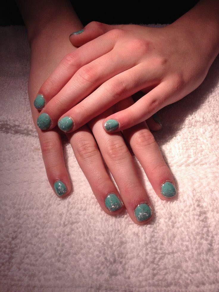 'The Tiffany' ~Aqua blue shellac with silver glitter gradient. Very classic.