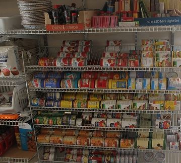 Yes, there are storage units like this for hundreds of dollars, but look what this gal did with ordinary shelving!  foodshelves.jpg