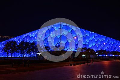 The Beijing National Aquatics Center is also called the water cube, which is its night photos, see the wall like a sea of blue, the waves of ups and downs, unique design, simple and beautiful. It is the 2008 Summer Olympic Games construction, is swimming pool. The water cube is the home court of Beijing landmark.