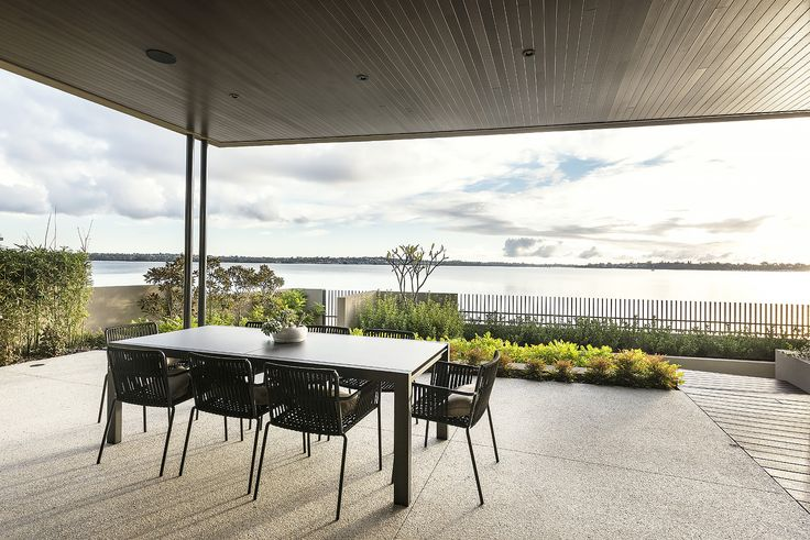 "Urbane Projects ""Natural Balance"" home, the perfect place to entertain with views of the lush garden and the sparkling Swan River. Outdoor Furniture by Mobilia."