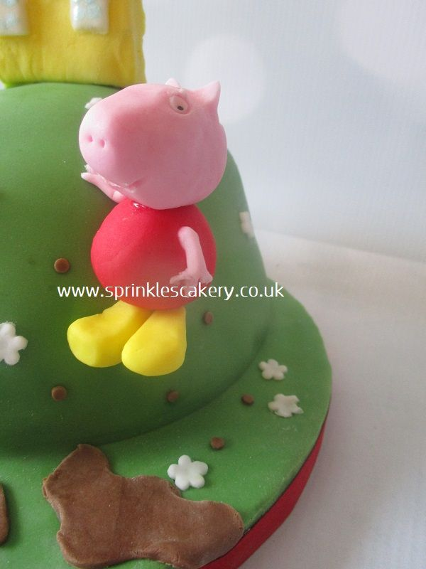 A handmade edible Peppa Pig made from fondant and modelling paste. Peppa was stuck on to the side of this cake with edible glue and with the help of a cocktail stick or two!