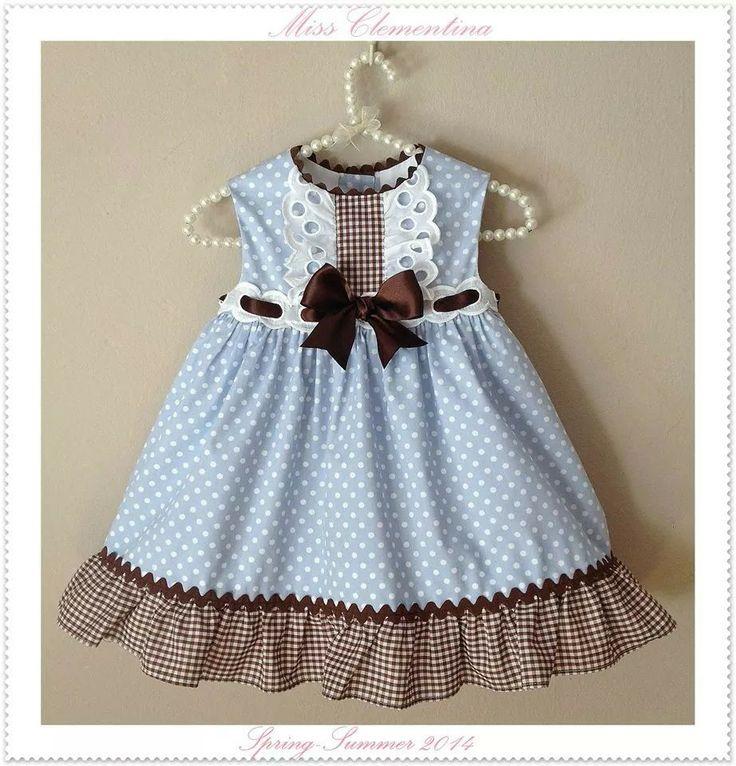 Blue sleeveless dress with brown ruffle on skirt. Cute.