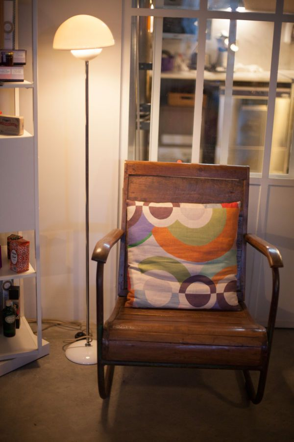 Vintage chair, lamp and pillow.
