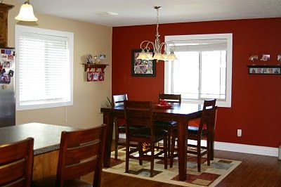 Love the one red wall, and the simple dining room table!