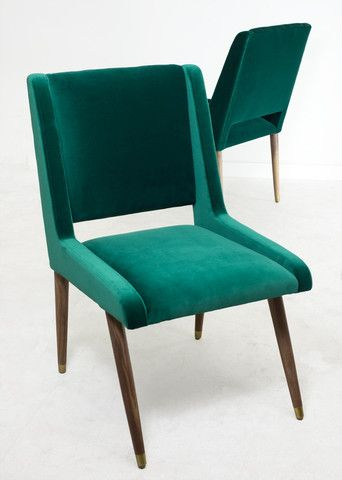 """$774 Dimensions: 20"""" Wide / 38"""" Tall / 22"""" Deep / 19"""" Seat Height   For the Mid Century modern home, these dining chairs are the perfect accent for your dining room. Upholstered in gorgeous Emerald Mohair with solid walnut legs"""