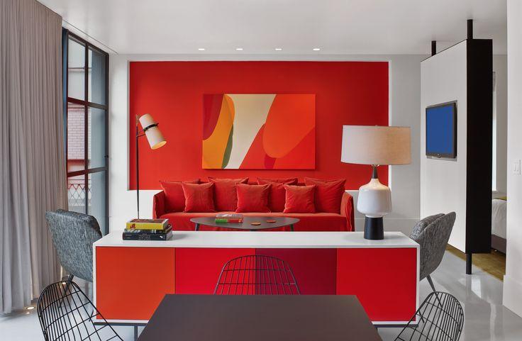 Ghost Sofa draped in orange velvet by Property Furniture.