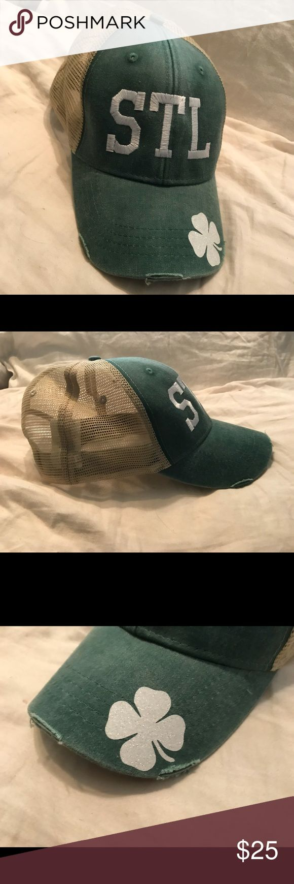 STL hat New, never used. I custom ordered this hat and it doesn't look right on me. Green with off white back, hat has a distressed look to it. STL is embroidered on the front in white, shamrock is white and sparkly. Back is adjustable. Price firm. Perfect Christmas gift for your St. Louis friend! Accessories Hats