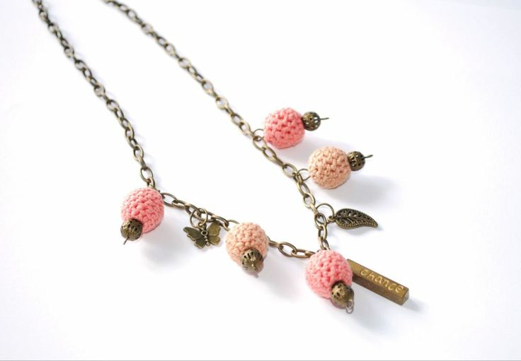Crocheted beads necklace with bronze color charms and accessories