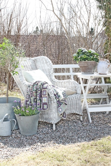 VIBEKE DESIGN old wicker and potted plants - nice vignette.
