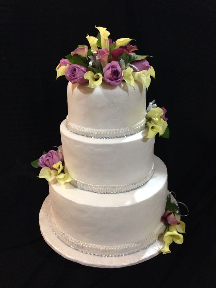 Made this wedding cake for our customer. Fresh calla lilies and lilac roses.