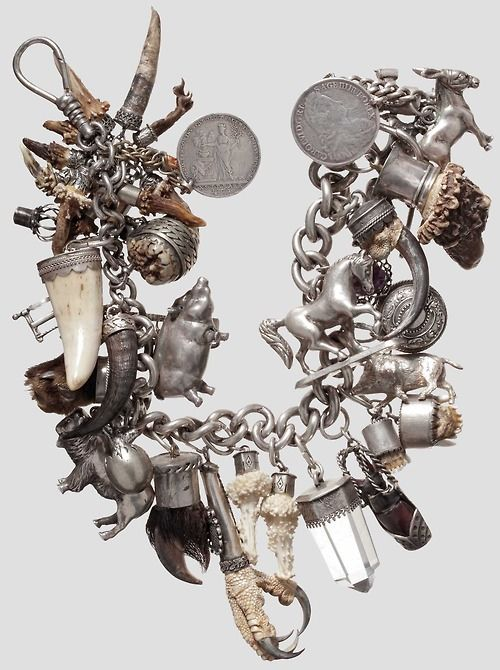 blackpaint20: Pomp Charivari, southern Germany, 19-20. century Tapered, heavy silver chain with side closures carabiner and twos. hooked coins. mostly encased in silver parts. Among then, raccoon, stag beetle, eagle claw, Rehgehörne, various animals and tools made of silver, etc., width 55 cm. Obsessed with these German and Austrian hunting amulets Charivari at the moment. Excuse me for spamming.