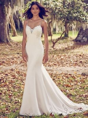 9cd55b5d Beaded lace motifs accent the bodice, illusion sweetheart neckline,  illusion back, and illusion cutout train in this Aldora Crepe sheath wedding  dress.